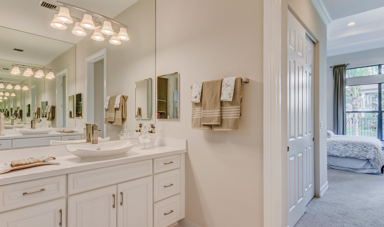 Dual vanities in owner's bath