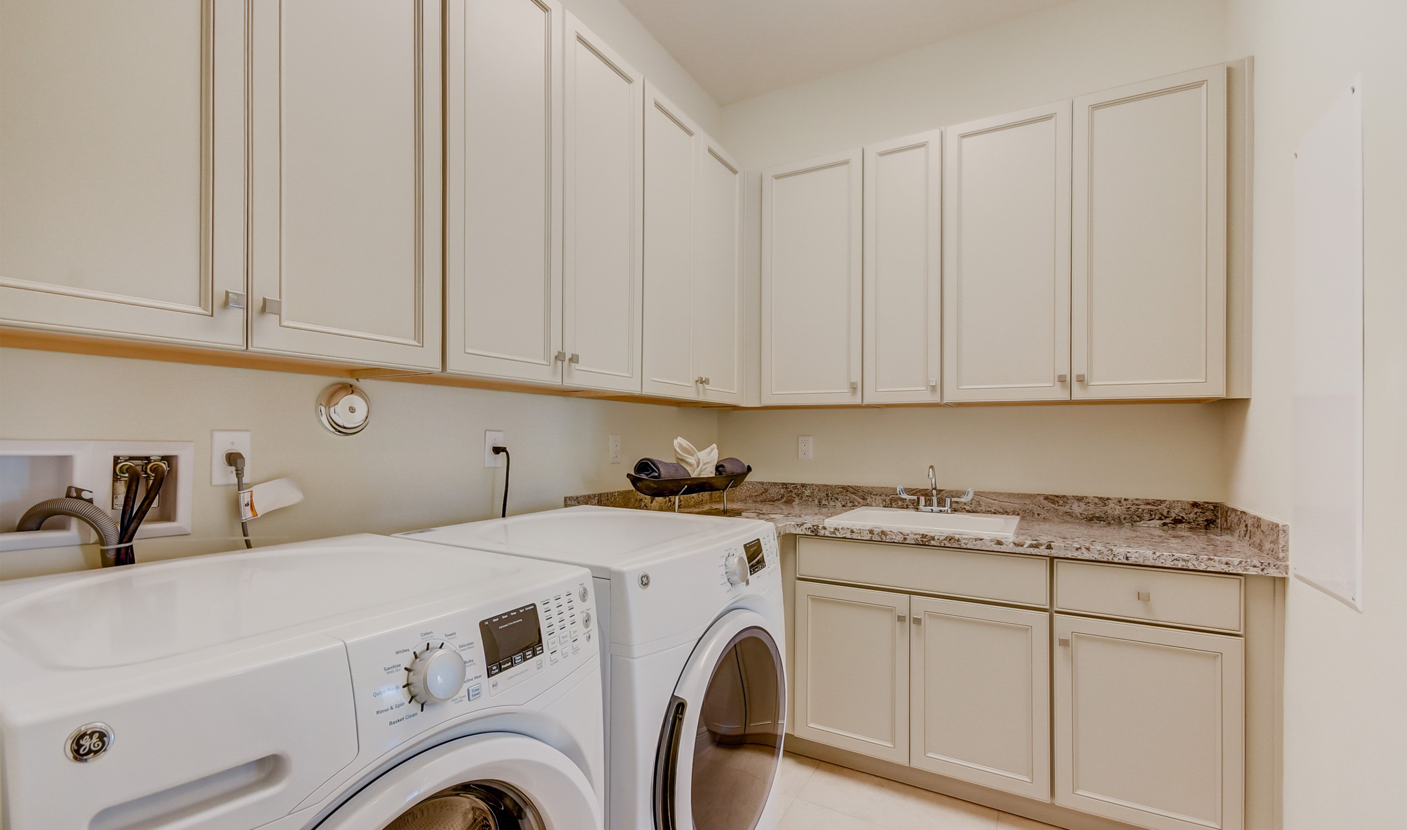 Laundry room with cabinet space