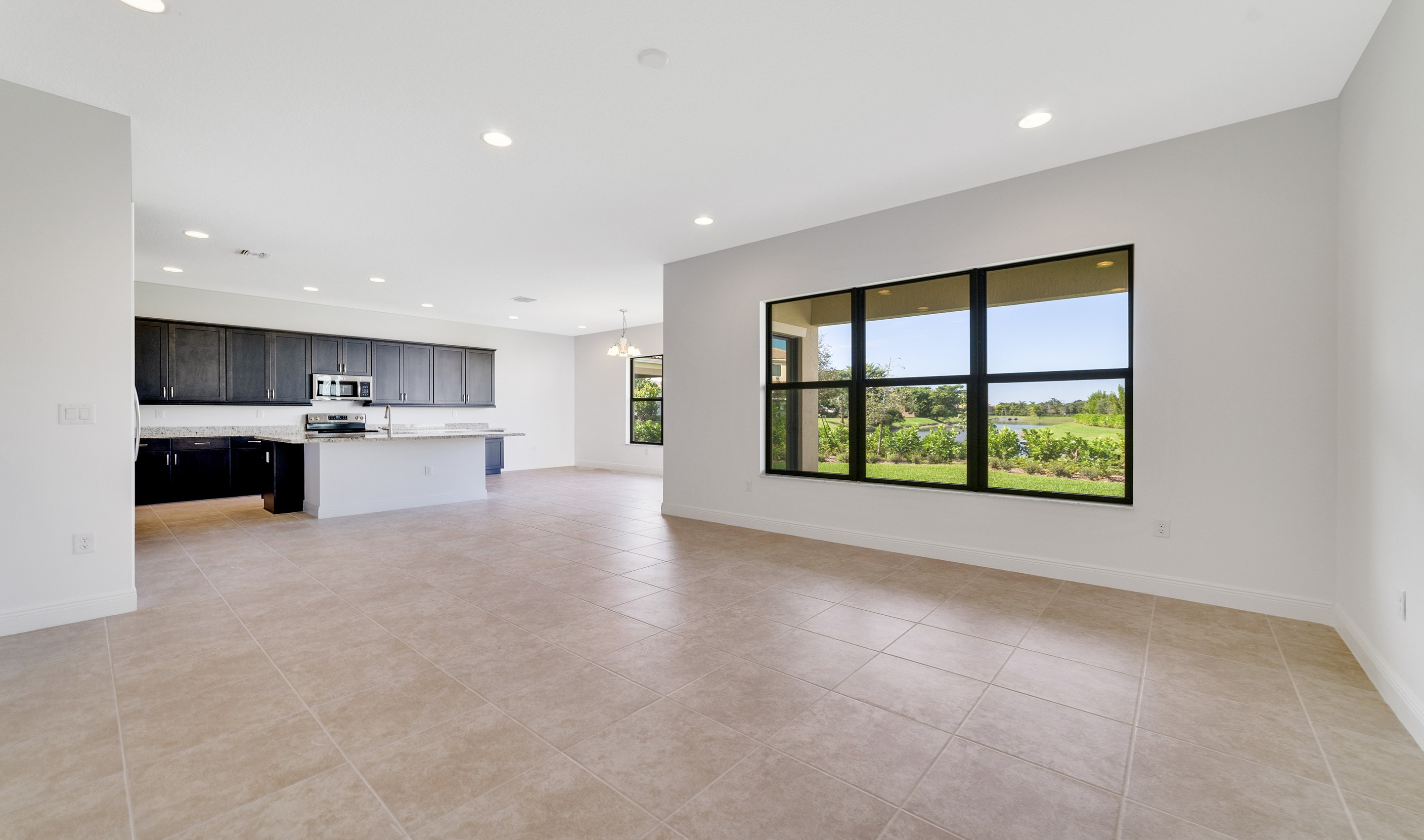 Great room, kitchen and dining area