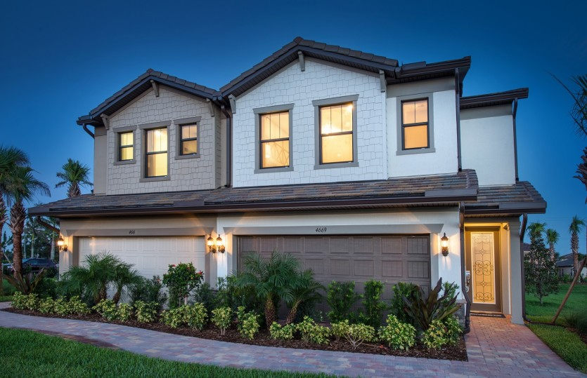 Leland: The Leland, a two-story town home with a 2 car garage, shown as the model Exterior at The Fields