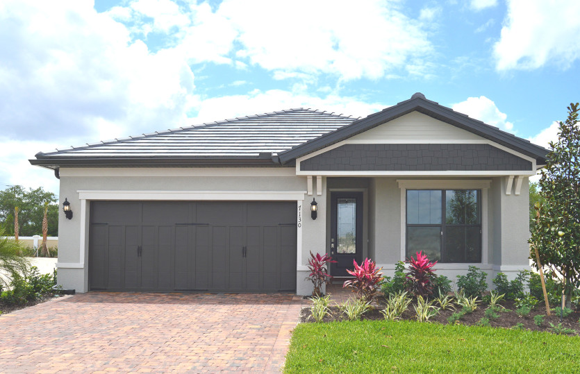 Orleans: The Orleans, a single-story family home with a 2 car garage, shown as actual Exterior C2A